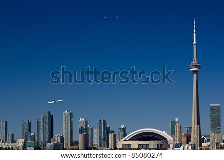 Toronto skyline with a tower and airplanes