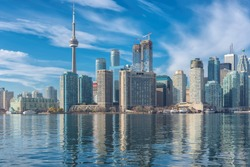 Toronto skyline with CN Tower with reflection in the lake. Canada.