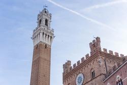 Torre del Mangia and Palazzo Pubblico in Piazza del Campo, Siena, Tuscany, Italy