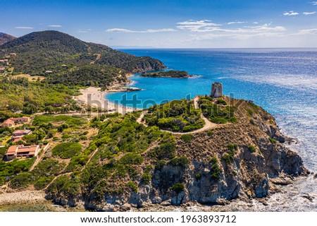 Torre di Chia view from flying drone. Acropoli di Bithia with Torre di Chia tower on background. Aerial view of Sardinia island, Italy, Europe. Panorama Of Chia Coast, Sardinia, Italy.  Stok fotoğraf ©