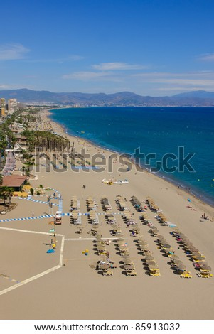 TORREMOLINOS - SEPTEMBER 01: Torremolinos beachfront. The Costa del Sol is a popular tourist region that welcomes millions of people annually on September 1, 2011 in Torremolinos Spain