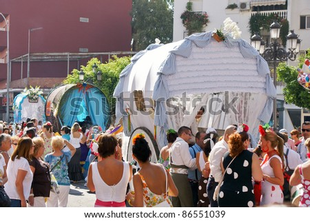 "TORREMOLINOS, SPAIN - SEPTEMBER 25:  Pilgrims in the traditional ""Romeria of San Miguel"" on September 25, 2011 in Torremolinos, Malaga, Spain. This festivity is the beginning of the fair."