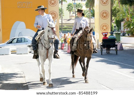 "TORREMOLINOS, SPAIN - SEPTEMBER 25:  Pilgrims participate in the traditional ""Romeria of San Miguel"" on September 25, 2011 in Torremolinos, Malaga, Spain. This festivity is the beginning of the fair."