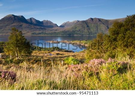 Torridon mountains over Torridon loch / Bright sunny day at Torridon loch and mountain range