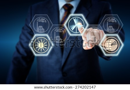 Torso of a corporate manager in business suit reaching out to touch a wind power icon The active wind symbol is lighting up together with a solar and geothermal energy button Energy turn metaphor