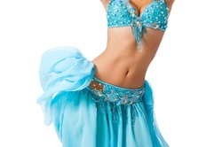 Torso of a female belly dancer wearing a light blue costume shaking her hips. Isolated on white.