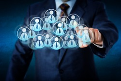 Torso of a manager in blue business suit selecting white color worker icons in a virtual cloud shaped of many office worker symbols. Technology metaphor combining smart computing and human resources.
