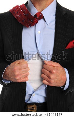 Torso of businessman opening shirt to reveal t-shirt