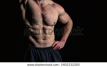Torso with six pack and ab muscles. Arm with strong biceps and triceps. Athletic belly and muscular chest. Workout and training activity in gym. Sport fitness and wellness concept.