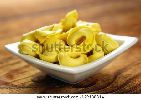 Tortellini, fresh egg pasta, italian food, selective focus