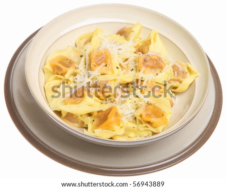 Tortellini pasta with grated Parmesan cheese.