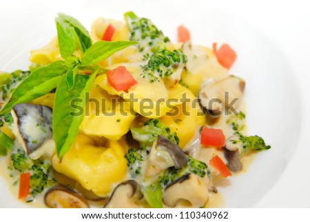 Tortellini pasta with mushroom, cabbage and cream sauce