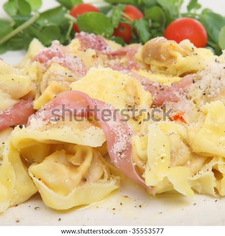 Tortellini pasta with Parma ham, Parmesan and pepper