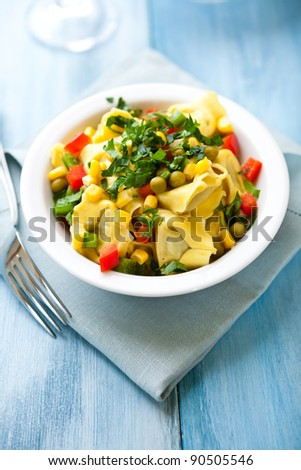 Tortellini with vegetables and fresh parsley
