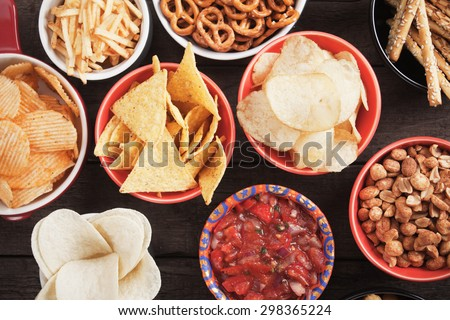 Tortilla chips and other salty snacks with homemade salsa Photo stock ©