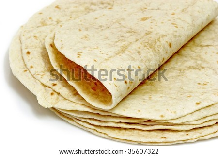 Tortilla flat bread on bright background