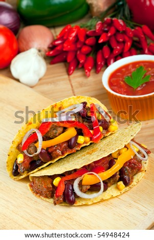 tortilla shells stuffed with meat sauce and beans