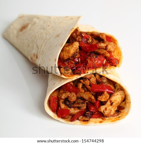 Tortilla with chicken and bell pepper. Isolated on a white background.