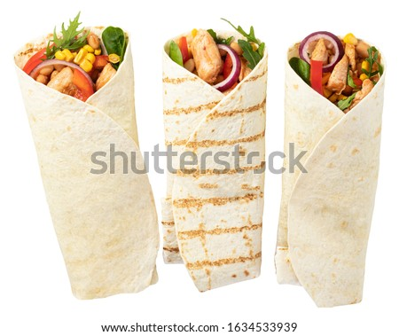 Photo of  Tortilla wrap with fried chicken meat and vegetables isolated on white background.