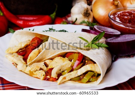 Tortilla wraps with chicken meat and grated vegetables