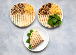 Tortillas with different fillings of mushrooms, cheese, spinach and fried egg. Food trend.