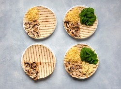 Tortillas with different fillings of mushrooms, cheese, spinach and fried egg. Food trend. Step by step photo instruction.
