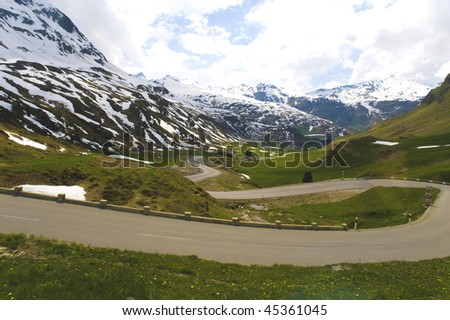 stock-photo-tortuous-road-along-the-snow-mountain-region-in-switzerland-45361045.jpg