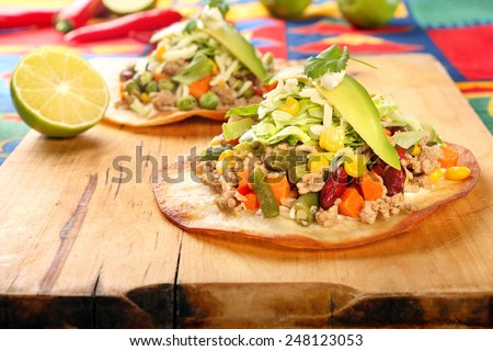Shutterstock Tostadas with ground beef and vegetables on wooden background
