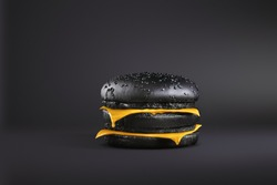 Total Painted in black burger with melting cheese. Painted food concept poster. Black friday sale. surrealism of food