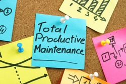 Total productive maintenance TPM on the blue memo stick.
