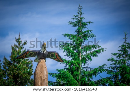 totems art and carvings at saxman village in ketchikan alaska #1016416540