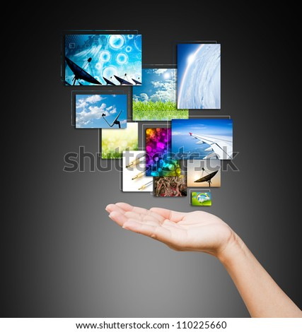 touch pad PC and streaming images buttons on women hand on background black