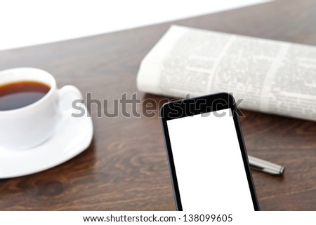 touch phone with isolated screen on a table at a businessman in office