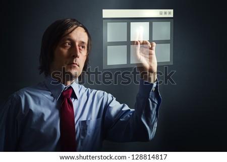 Touch screen. Businessman pressing digital touch screen button interface.