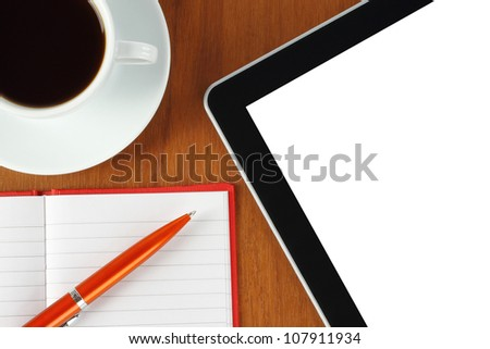 Touch screen device, notepad, pen and cup of coffee on wooden background