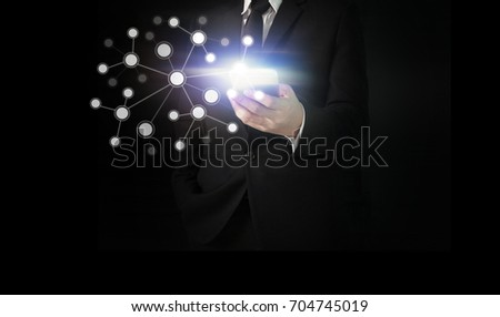 Touch screen smartphone in a  hand #704745019