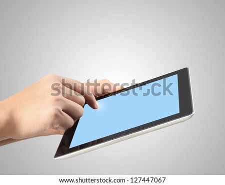 touch screen tablet and shows tablet in hand