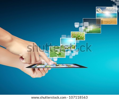 touch tablet concept images streaming from in hand