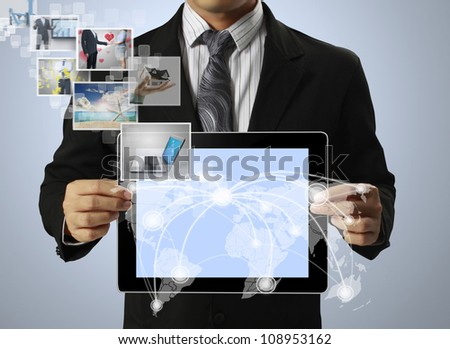 touch tablet concept images streaming from in hand - stock photo
