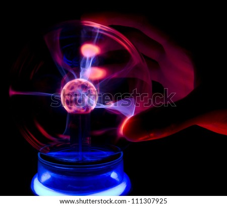 Touching a plasma lamp with five fingers #111307925