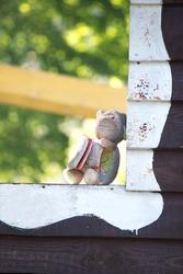 touching  forgotten  teddy lamb at playground