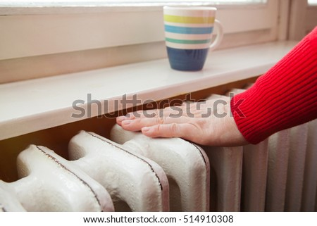 touching the radiator to check whether heated