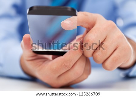 Touchscreen futuristic transparent gadget in businessman hands