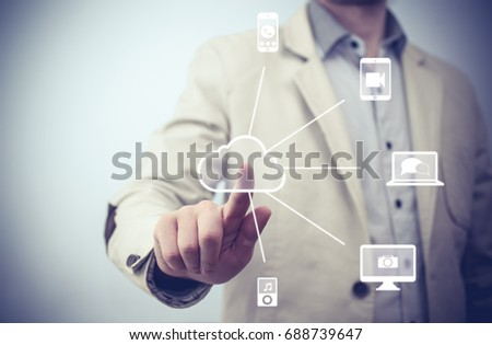Touchscreen Interface. futuristic display: Cloud computing touchscreen interface. Businessman pressing virtual icons  #688739647