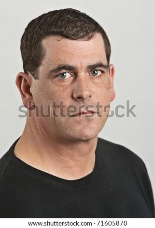 Tough adult man serious expression portrait
