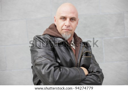 Tough bald man with a leather jacket