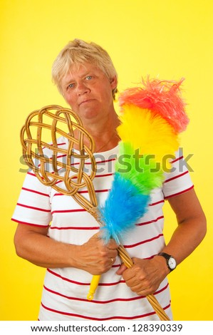Tough elderly woman ready for cleaning the house