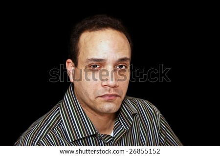 tough guy portrait of african american male wearing striped shirt against black background