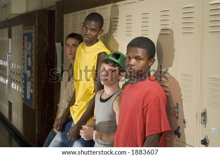 Tough guys at school hanging around the locker.  Great for peer-pressure communication.  The BAD crowd.