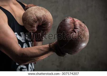 Tough male in vintage boxing gloves